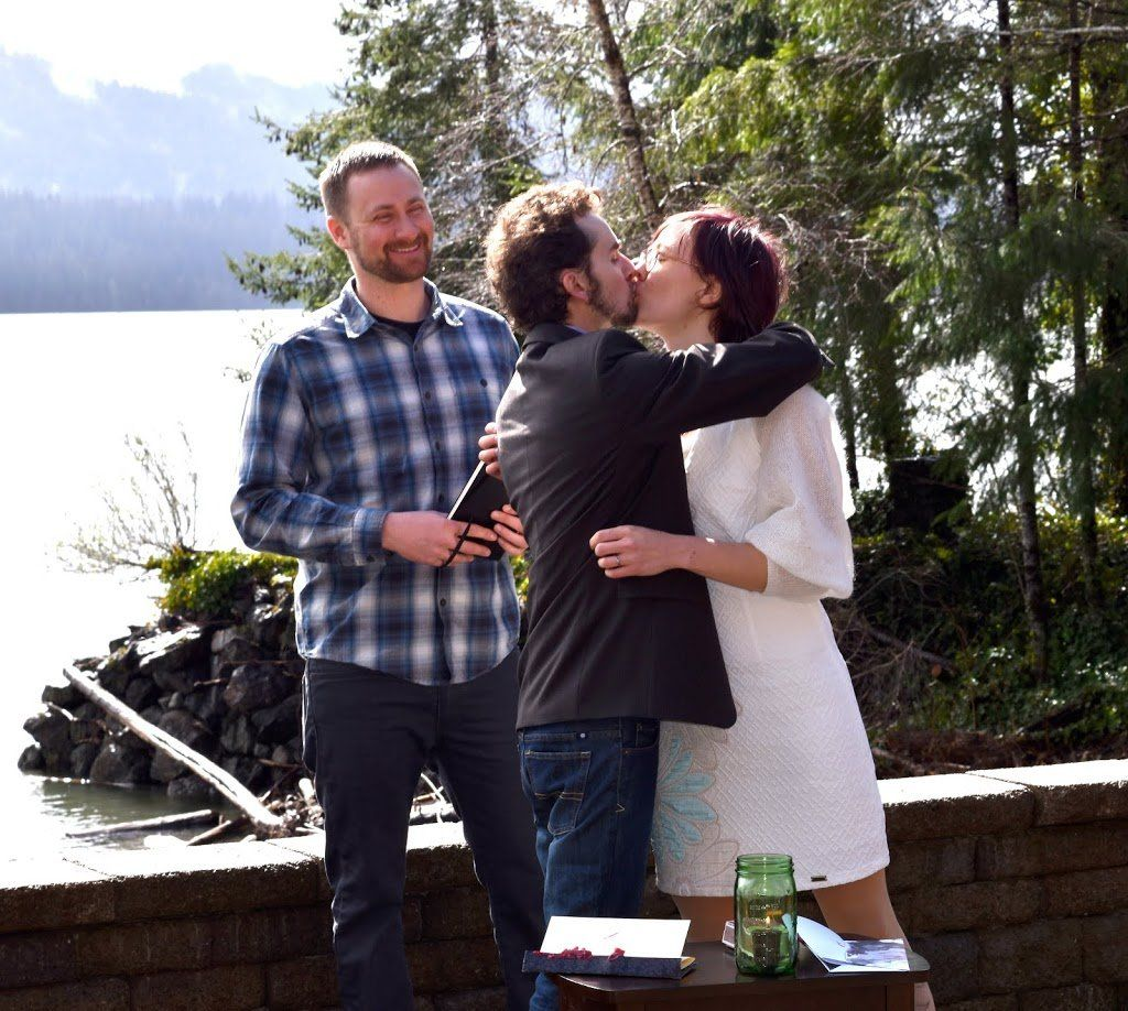 Two people kissing in wedding attire. It's pretty sappy.